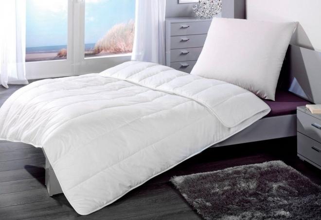Односпальное одеяло размером 140 на 205 см